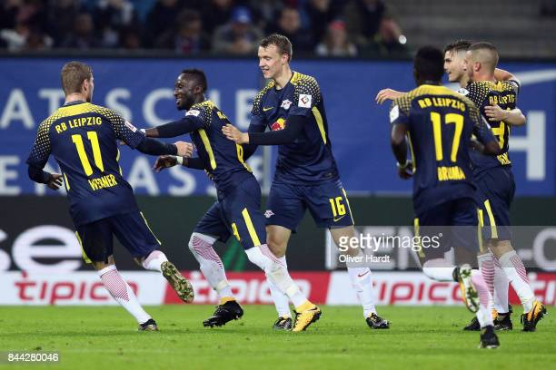 Naby Keita of Leipzig celebrates his team's first goal with team mates during the Bundesliga match between Hamburger SV and RB Leipzig at...