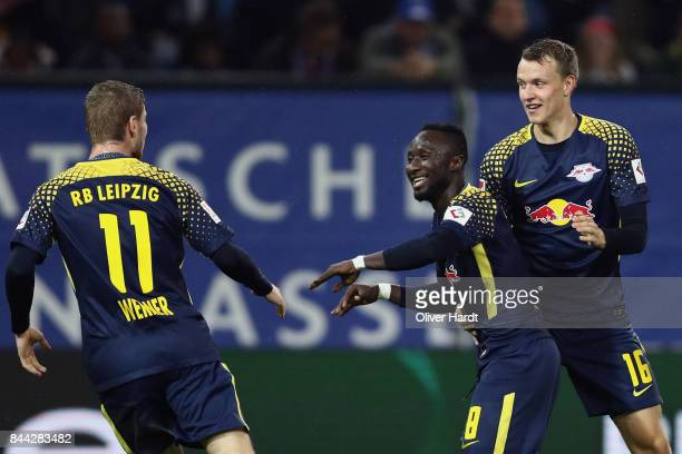 Naby Keita of Leipzig celebrates his team's first goal with team mates Timo Werner and Lukas Klostermann during the Bundesliga match between...