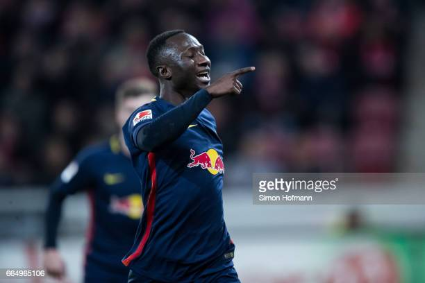Naby Keita of Leipzig celebrates his team's third goal during the Bundesliga match between 1 FSV Mainz 05 and RB Leipzig at Opel Arena on April 5...