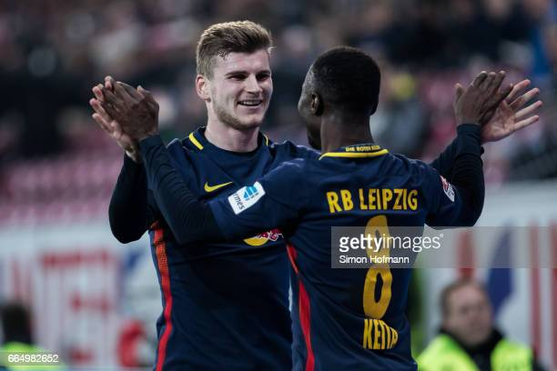 Naby Keita of Leipzig celebrates his team's third goal with team mate Timo Werner during the Bundesliga match between 1 FSV Mainz 05 and RB Leipzig...