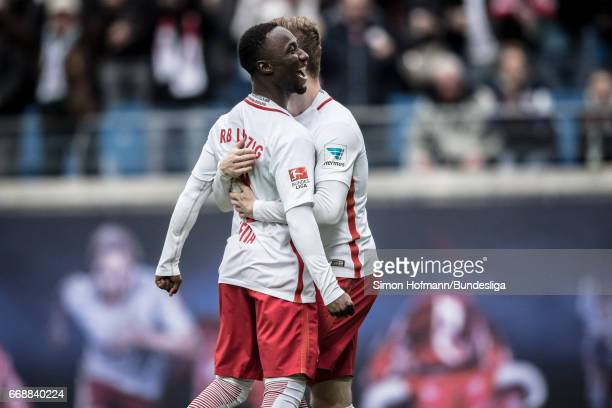 Naby Keita of Leipzig celebrates his team's third goal with team mate Timo Werner during the Bundesliga match between RB Leipzig and SC Freiburg at...