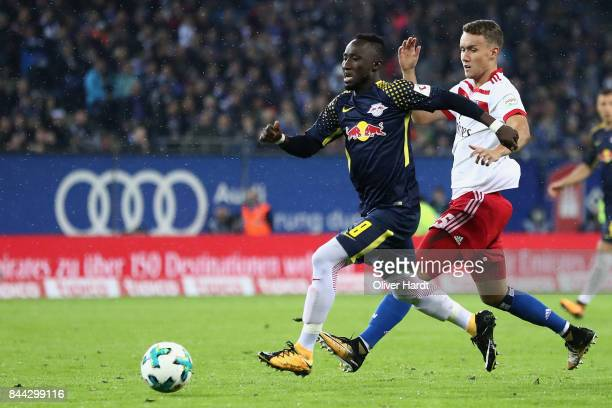Naby Keita of Leipzig eludes Luca Waldschmidt of Hamburg during the Bundesliga match between Hamburger SV and RB Leipzig at Volksparkstadion on...