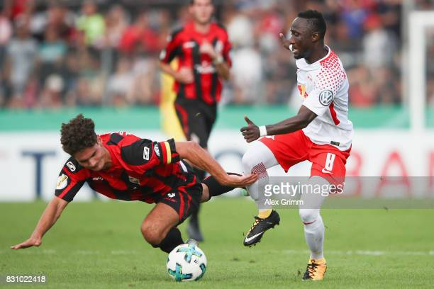 Naby Keita of Leipzig is challenged by Niklas Weissenberger of Dorfmerkingen during the DFB Cup first round match between Sportfreunde Dorfmerkingen...