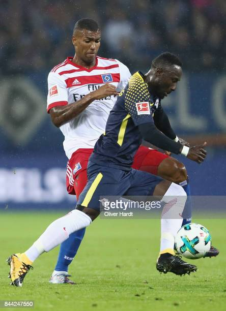 Naby Keita of Leipzig is challenged by Walace of Hamburg during the Bundesliga match between Hamburger SV and RB Leipzig at Volksparkstadion on...