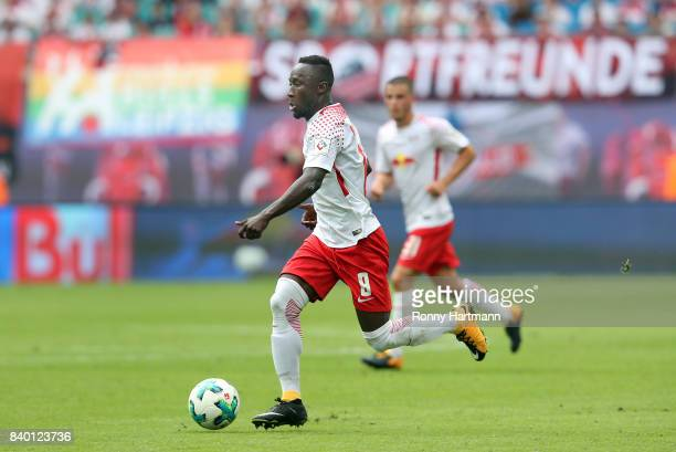 Naby Keita of Leipzig runs with the ball during the Bundesliga match between RB Leipzig and SportClub Freiburg at Red Bull Arena on August 27 2017 in...
