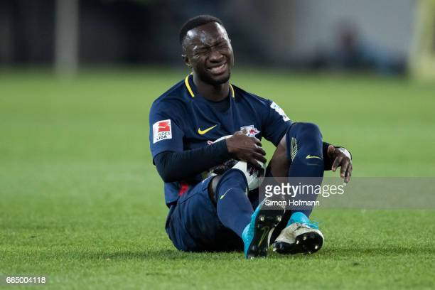 Naby Keita of Leipzig sits on the pitch and reacts during the Bundesliga match between 1 FSV Mainz 05 and RB Leipzig at Opel Arena on April 5 2017 in...
