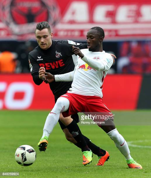 Naby Keita of Leipzig vies with Christian Clemens of Koeln during the Bundesliga match between RB Leipzig and 1 FC Koeln at Red Bull Arena on...