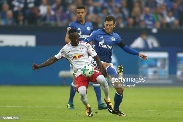 Naby Keita of Leipzig with Leon Goretzka of Schalke during the Bundesliga match between FC Schalke 04 and RB Leipzig at VeltinsArena on August 19...