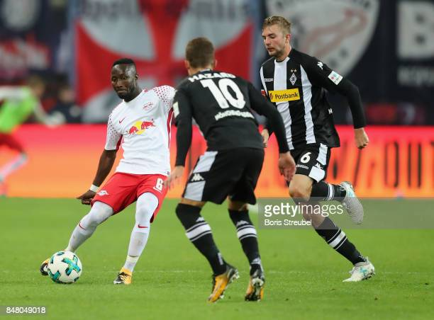 Naby Keita of RB Leipzig battles for the ball with Christoph Kramer of Borussia Moenchengladbach during the Bundesliga match between RB Leipzig and...