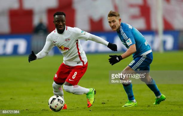 Naby Keita of RB Leipzig is challenged by Lewis Holtby of Hamburger SV during the Bundesliga match between RB Leipzig and Hamburger SV at Red Bull...