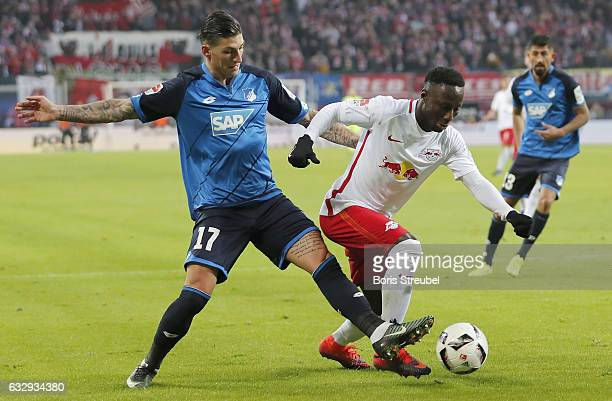 Naby Keita of RB Leipzig is challenged by Steven Zuber of TSG Hoffenheim during the Bundesliga match between RB Leipzig and TSG 1899 Hoffenheim at...