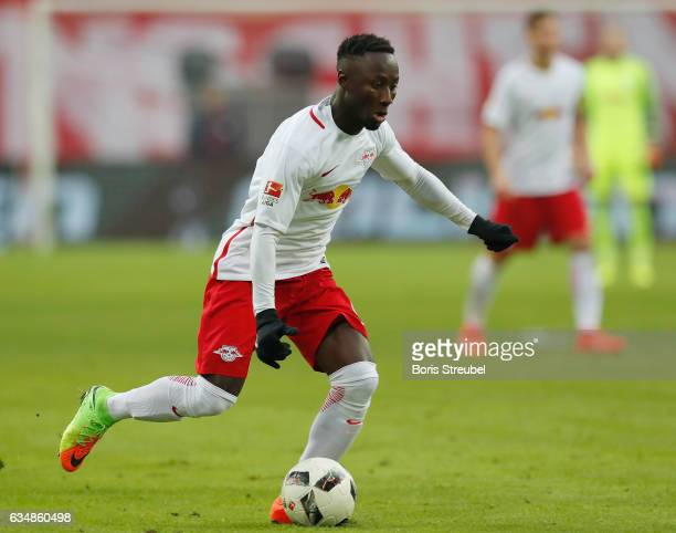 Naby Keita of RB Leipzig runs with the ball during the Bundesliga match between RB Leipzig and Hamburger SV at Red Bull Arena on February 11 2017 in...