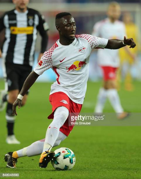 Naby Keita of RB Leipzig runs with the ball during the Bundesliga match between RB Leipzig and Borussia Moenchengladbach at Red Bull Arena on...