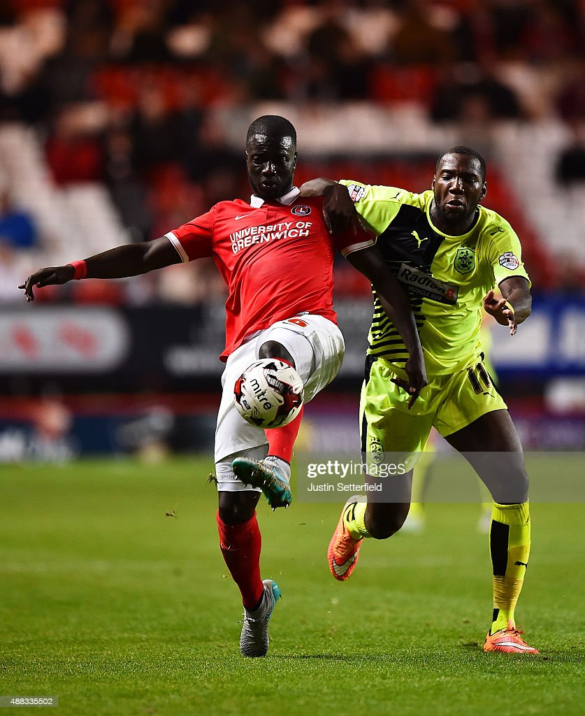 Naby Sarr of Charlton and <a gi-track='captionPersonalityLinkClicked' href=/galleries/search?phrase=Ishmael+Miller&family=editorial&specificpeople=2070486 ng-click='$event.stopPropagation()'>Ishmael Miller</a> of Huddersfield Town during the Sky Bet Championship match between Charlton Athletic and Huddersfield Town at The Valley on September 15, 2015 in London, England.