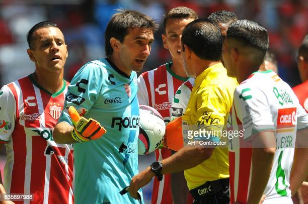Nacaxa's goalkeeper Marcelo Barovero argues with referee Jose Penaloza during the Mexican Apertura football tournament match against Toluca at the...