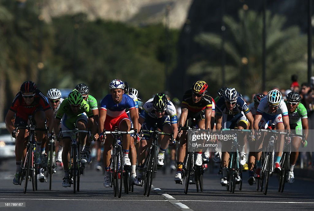 Nacer Bouhanni of France and FDJ crosses the finish line to win stage six of the 2013 Tour of Oman from Hawit Nagam Park to the Matrah Corniche on February 16, 2013 in Matrah, Oman.