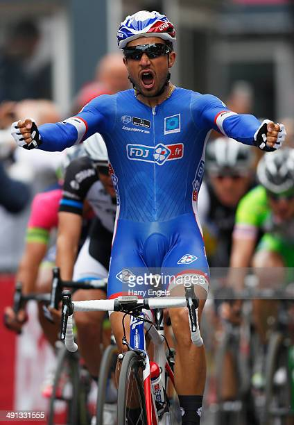 Nacer Bouhanni of France and FDJfr celebrates crossing the finish line to win the seventh stage of the 2014 Giro d'Italia a 211 km stage between...
