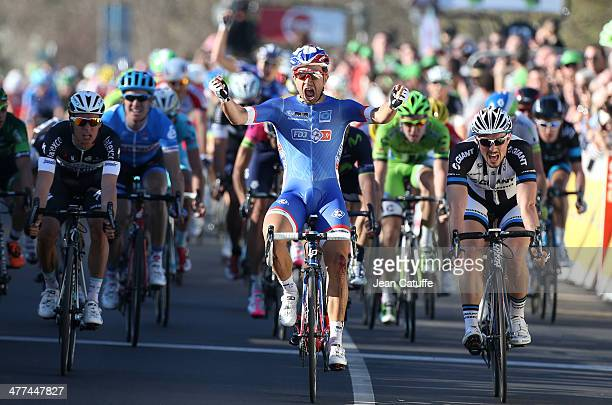 Nacer Bouhanni of France and Team FDJ wins the sprint finish in front of John Degenkolb of Germany and Team GiantShimano and Gianni Meersman of...