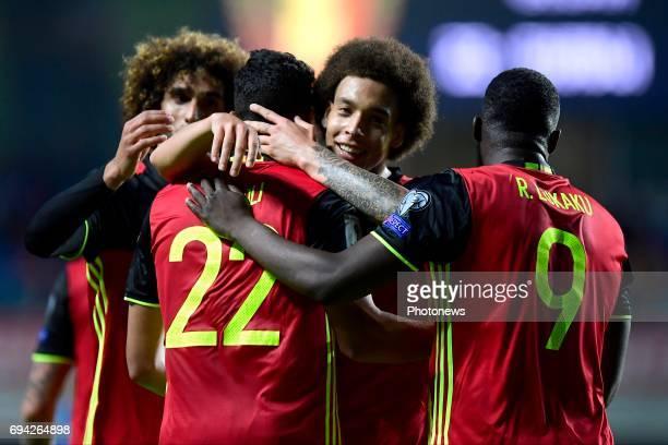 Nacer Chadli midfielder of Belgium celebrates scoring a goal with teammates Axel Witsel midfielder of Belgium and Romelu Lukaku forward of...