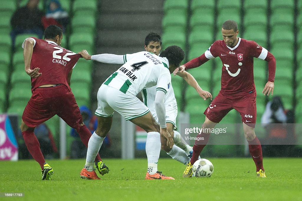 Nacer Chadli of FC Twente, Virgil van Dijk of FC Groningen, Luc Castaignos of FC Twente during the Eredivisie Europa League Playoff match between FC Groningen and FC Twente on May 16, 2013 at the Euroborg stadium at Groningen, The Netherlands.