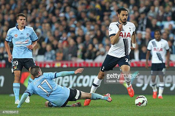 Nacer Chadli of Hotspur makes a break past Terry Antonis of Sydney FC during the international friendly match between Sydney FC and Tottenham Spurs...