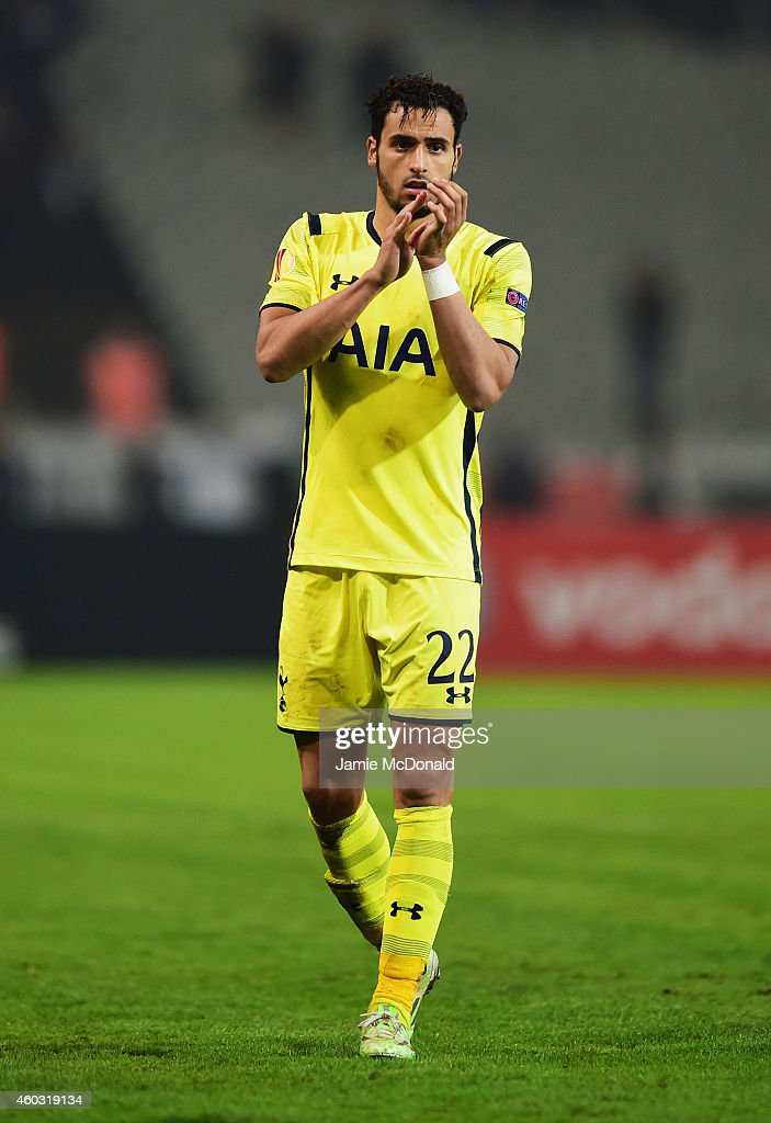 Nacer Chadli of Spurs applauds the travelling fans after defeat in the UEFA Europa League Group C match between Besiktas JK and Tottenham Hotspur FC at Ataturk Olympic Stadium on December 11, 2014 in Istanbul, Turkey.