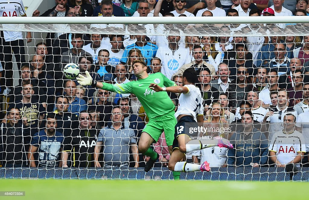 <a gi-track='captionPersonalityLinkClicked' href=/galleries/search?phrase=Nacer+Chadli&family=editorial&specificpeople=7132461 ng-click='$event.stopPropagation()'>Nacer Chadli</a> of Spurs heads past Robert Green of QPR to score his team's third goal during the Barclays Premier League match between Tottenham Hotspur and Queens Park Rangers at White Hart Lane on August 24, 2014 in London, England.