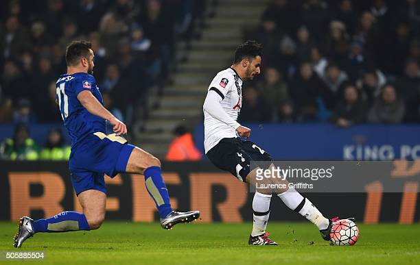 Nacer Chadli of Spurs scores his team's second goal as Marcin Wasilewski of Leicester City closes in during the Emirates FA Cup Third Round Replay...