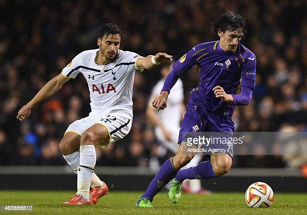 Nacer Chadli of Tottenham Hotspur and Stefan Savic of Fiorentina in action during the UEFA Europa League Round of 32 First Leg match between...