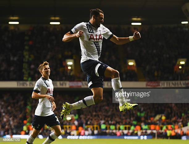 Nacer Chadli of Tottenham Hotspur celebrates as Calum Chambers of Arsenal scores an own goal for their first goal from his cross during the Capital...