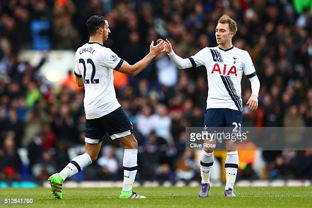 Nacer Chadli of Tottenham Hotspur celebrates scoring his goal with Christian Eriksen during the Barclays Premier League match between Tottenham...
