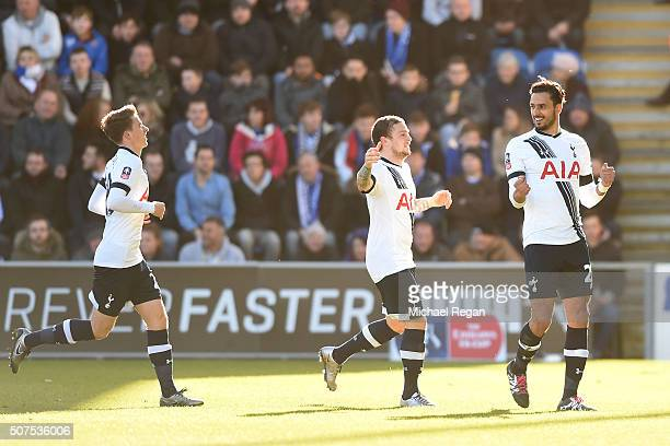 Nacer Chadli of Tottenham Hotspur celebrates scoring his team's first goal with his team mates Kieran Trippier and Tom Carroll during the Emirates FA...