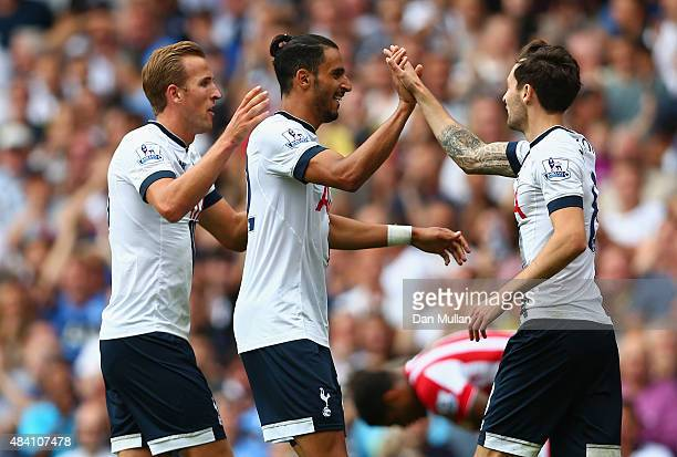 Nacer Chadli of Tottenham Hotspur celebrates scoring his team's second goal with his team mates Harry Kane and Ryan Mason during the Barclays Premier...
