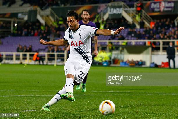 Nacer Chadli of Tottenham Hotspur converts the penalty kick to score his team's first goal during the UEFA Europa League round of 32 first leg match...