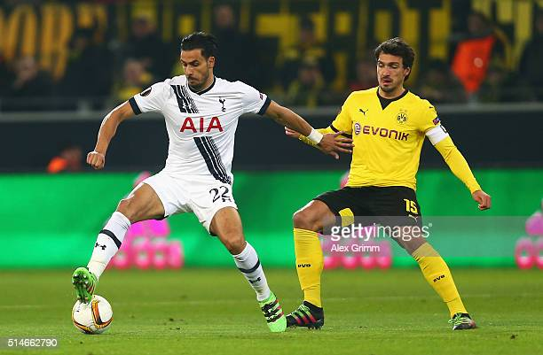 Nacer Chadli of Tottenham Hotspur holds off Mats Hummels of Borussia Dortmund during the UEFA Europa League Round of 16 first leg match between...