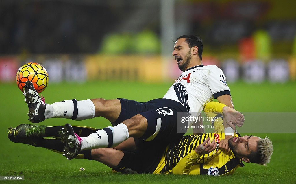 Nacer Chadli of Tottenham Hotspur is tackled by Valon Berami of Watford during the Barclays Premier League match between Watford and Tottenham Hotspur at Vicarage Road on December 28, 2015 in Watford, England.