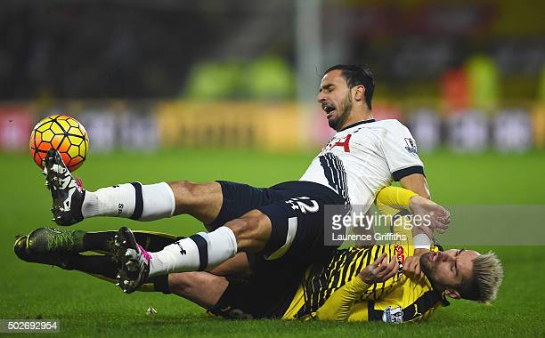 Nacer Chadli of Tottenham Hotspur is tackled by Valon Berami of Watford during the Barclays Premier League match between Watford and Tottenham...