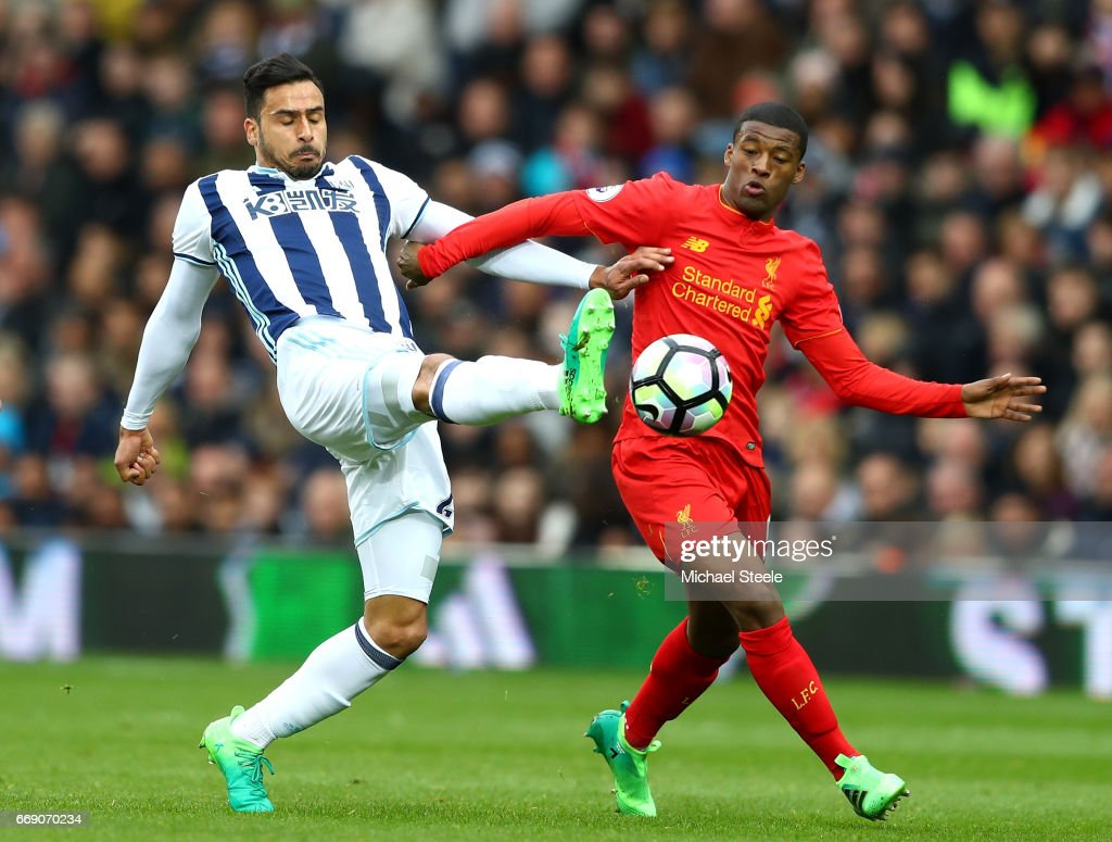 Nacer Chadli of West Bromwich Albion and Georginio Wijnaldum of Liverpool battle for possession during the Premier League match between West Bromwich Albion and Liverpool at The Hawthorns on April 16, 2017 in West Bromwich, England.