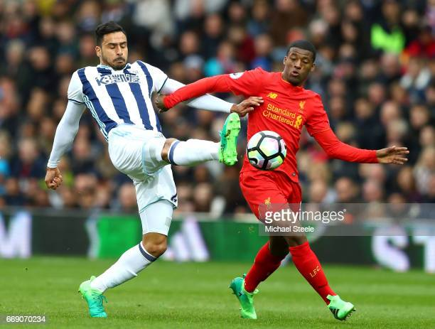 Nacer Chadli of West Bromwich Albion and Georginio Wijnaldum of Liverpool battle for possession during the Premier League match between West Bromwich...