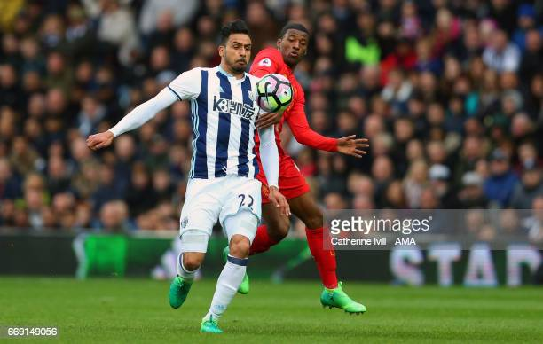 Nacer Chadli of West Bromwich Albion and Georginio Wijnaldum of Liverpool during the Premier League match between West Bromwich Albion and Liverpool...