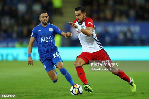 Nacer Chadli of West Bromwich Albion and Riyad Mahrez of Leicester City during the Premier League match between Leicester City and West Bromwich...