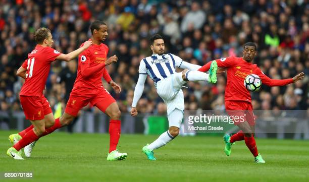 Nacer Chadli of West Bromwich Albion attempts to control the ball while under pressure from Georginio Wijnaldum of Liverpool Joel Matip of Liverpool...