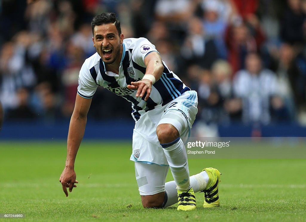 Nacer Chadli of West Bromwich Albion celebrates scoring his sides first goal during the Premier League match between West Bromwich Albion and West Ham United at The Hawthorns on September 17, 2016 in West Bromwich, England.