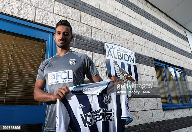 Nacer Chadli signs for WBA at West Bromwich Albion Training Ground on August 29 2016 in Walsall England