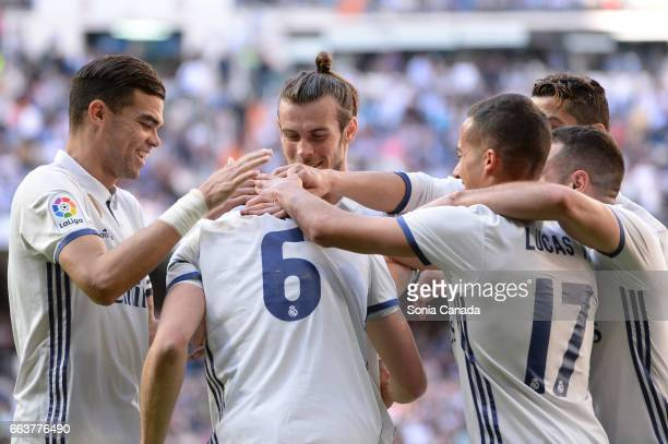 Nacho #6 of Real Madrid celebrates after scoring his team's third goal during the La Liga match between Real Madrid CF v Deportivo Alaves at Santiago...