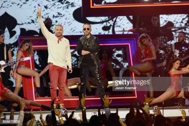 Nacho and Yandel perform on stage at Telemundo's 2017 'Premios Tu Mundo' at American Airlines Arena on August 24 2017 in Miami Florida
