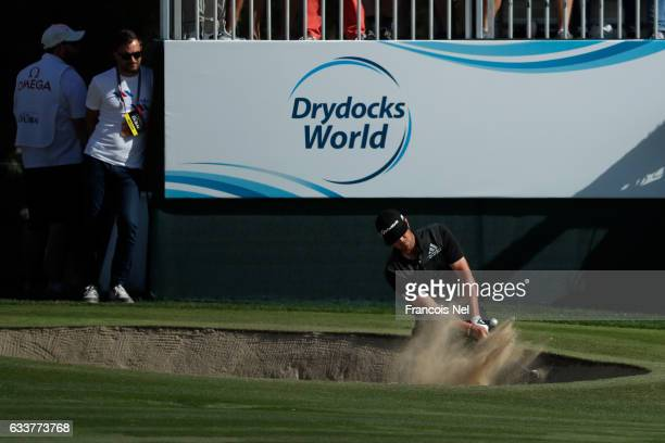 Nacho Elvira of Spain hits from a bunker during the third round of the Omega Dubai Desert Classic at Emirates Golf Club on February 4 2017 in Dubai...