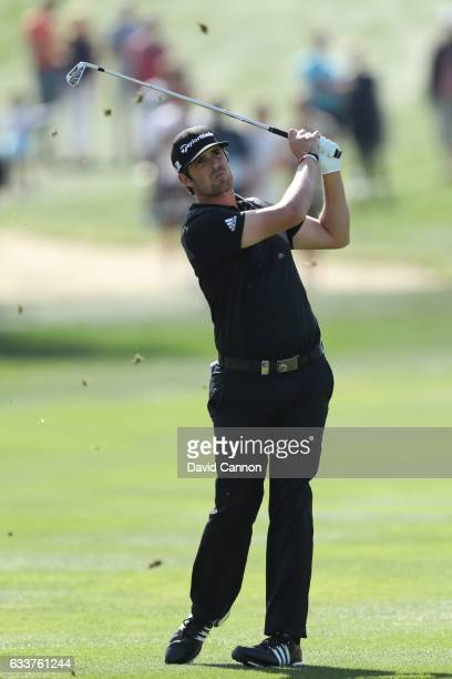 Nacho Elvira of Spain hits his second shot on the 1st hole during the third round of the Omega Dubai Desert Classic at Emirates Golf Club on February...