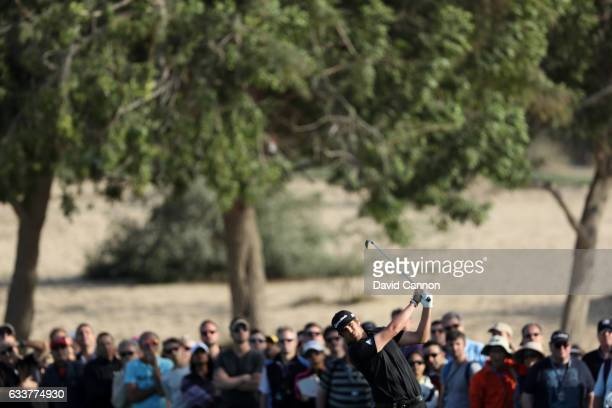 Nacho Elvira of Spain hits his second shot on the 8th hole during the third round of the Omega Dubai Desert Classic at Emirates Golf Club on February...