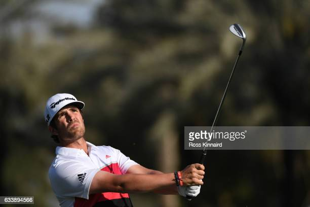 Nacho Elvira of Spain hits his third shot on the 18th hole during the final round of the Omega Dubai Desert Classic at Emirates Golf Club on February...